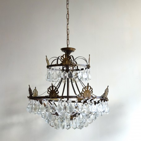 french chandelier with brass frame and crest detailing