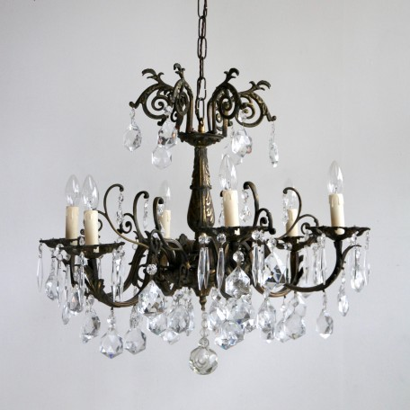 French 1920s ornate brass chandelier dressed in hand cut crystal and crystal icicles.