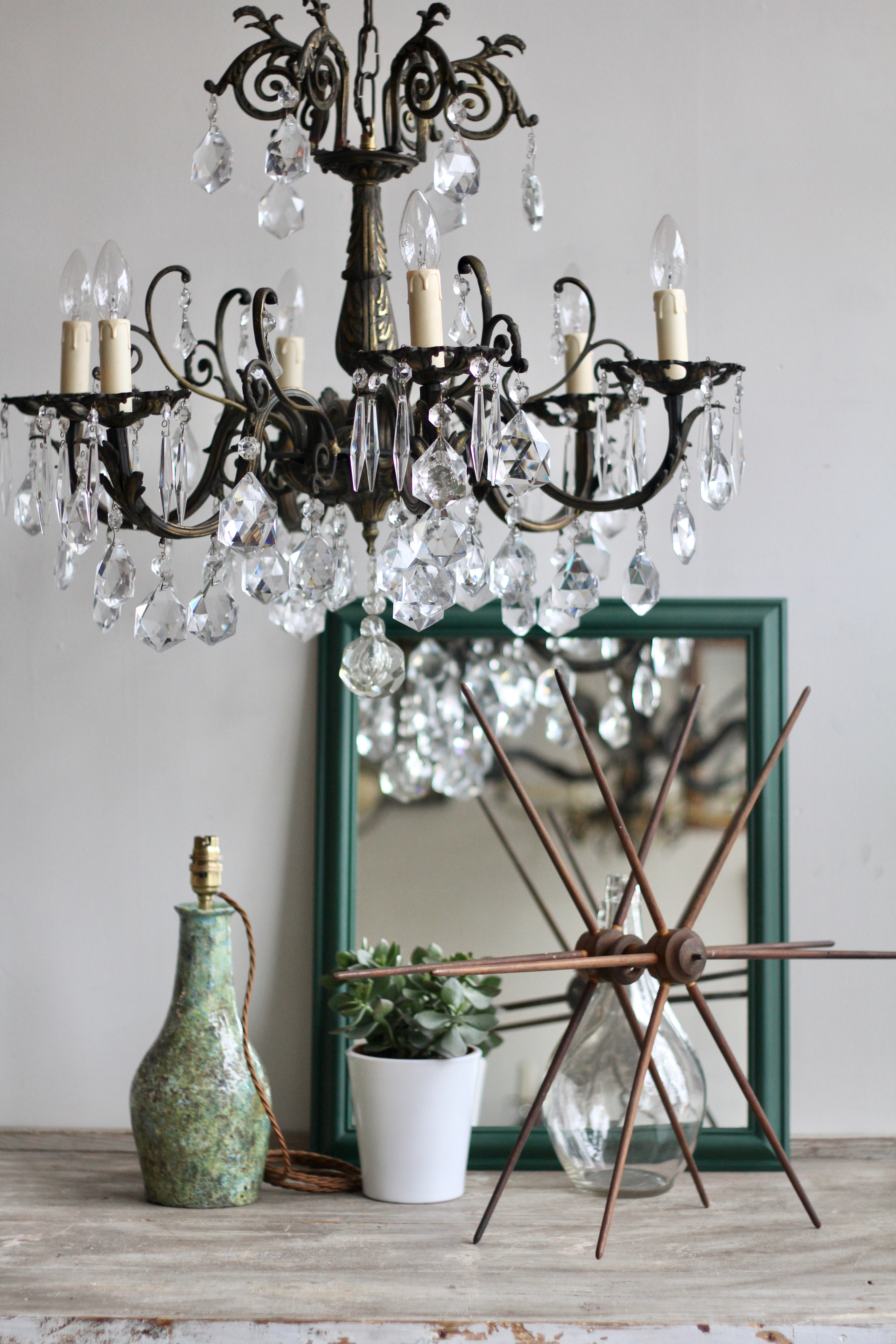 Shop Styling. Ornate Brass Chandelier with Annie Sloan painted Mirror, Textile Swift and Pottery Lamp.