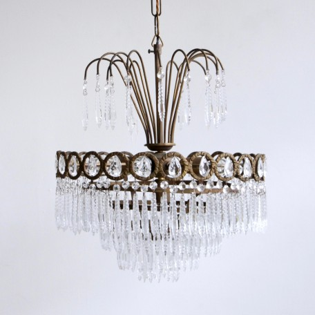 Decorative Waterfall Chandelier dressed in faceted icicles. Originates from early 1900s France. Glass pear drops in the frame. Fully rewired and restored.