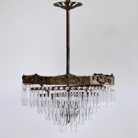 Octagonal Waterfall Chandelier dressed in faceted icicle drops. Early 1920s French Chandelier with decorative octagonal brass frame. Rewired and restored.