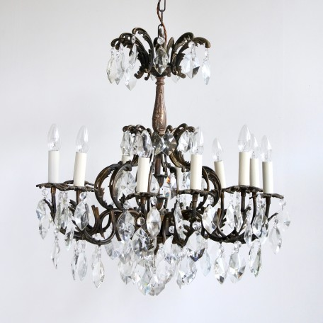 Ornate Chandelier with cut crystal drops. Dating from early 1900s France its twelve arm partially polished brass frame is decorated with brass leaves.