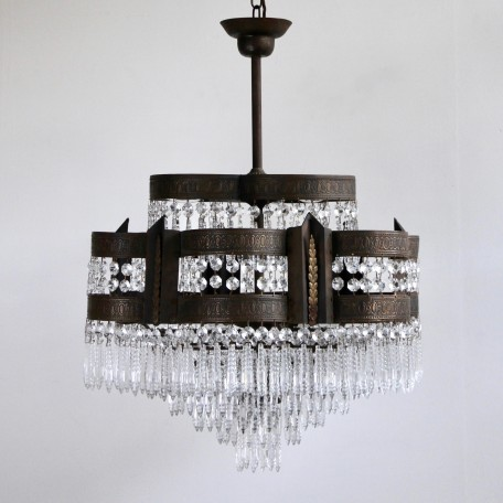 Pair of Waterfall Chandeliers dressed in faceted icicle drops. Petal shaped frames with brass leaf details. Nine lamps per chandelier. Early 1900s France.