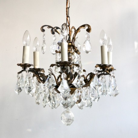 Ornate Brass Chandelier with cut crystal drops. Naturally oxidised brass frame that is dressed in cut crystal kite and square cut pear drops. Originating from early 1900s France. It has been fully restored and rewired here, in Stockport, near Manchester.