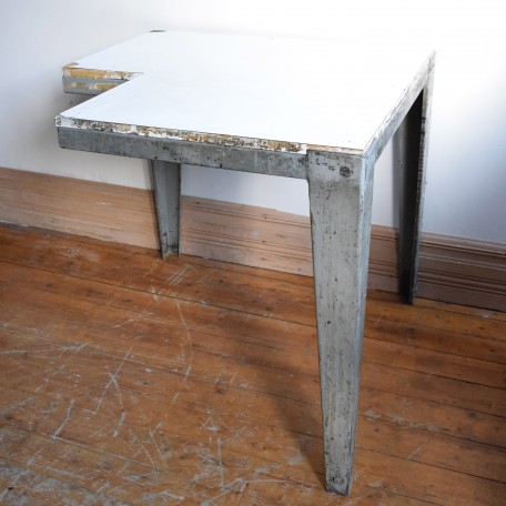 pair of industrial tables