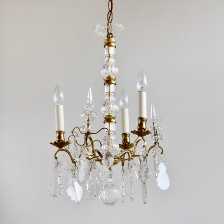 Three Arm Louis XIV Style Chandelier with glass stem and flat leaf drops. Originating from early 1900s France. Lacquered polished brass.