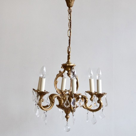 Small Heavy Cast Chandelier dressed in glass flat leaf drops with glass buttons. Chandelier originates from early 1900s France. Fully rewired and restored.
