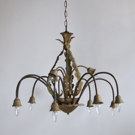Large Floral Chandelier with brass arms and twelve lamps. Originating from 1930s France. Decorative floral frame sprayed with brass effect paint.