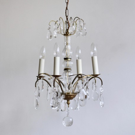 Louis XIV Style Chandelier with brass frame, glass stem and crystal drops finished with star shaped glass rosettes. Originating from early 1900s France.