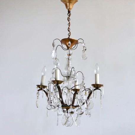 Louis XIV Style Chandelier with it's original crystal and glass. The crystal drops hang with delicate amber beads or crystal buttons. Early 1900s France.