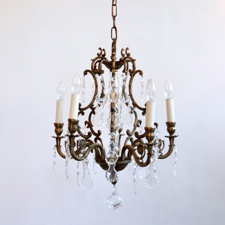 Small Ornate Brass Chandelier dressed in various shapes of glass flat leaf drops. Made from scrolled brass with a central glass stem and uses six lamps.