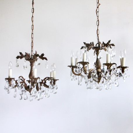 Ornate Brass Chandeliers dressed in cut crystal pear drops. Chandeliers originate from early 1900s France. Can be purchased as a pair or separately.