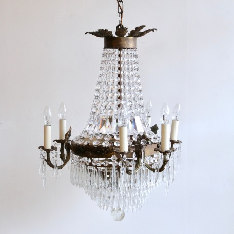 This French tiered and branch chandelier is a fine gilt early 20th Century chandelier. The brass frame has formed a beautiful patina and is dressed in glass buttons and glass icicle droppers.