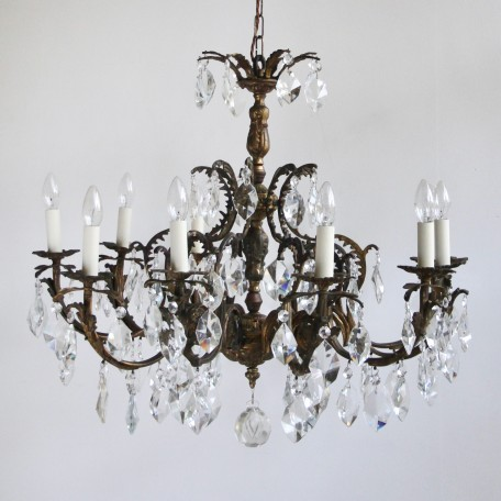 Large Ornate Chandelier with cut crystal drops. Dating from early 1900s France its ten arm partially polished brass frame is decorated with brass leaves