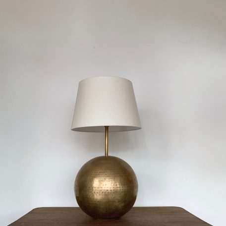 Stylish French Mid Century globe hammered brass lamp