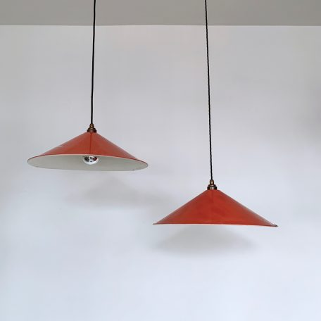 Vintage red enamel metal shades with characterful wear