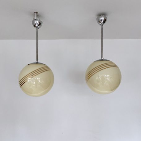 Pair of Mid Century Yellow Polished Globes with Gold Bands