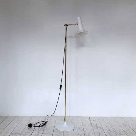 Mid Century French Brass and painted metal floor lamp with adjustable angled shade. Newly wired with black braided flex, inline switch and three pin plug.