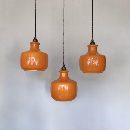 Three 1970s Orange Glass Shades
